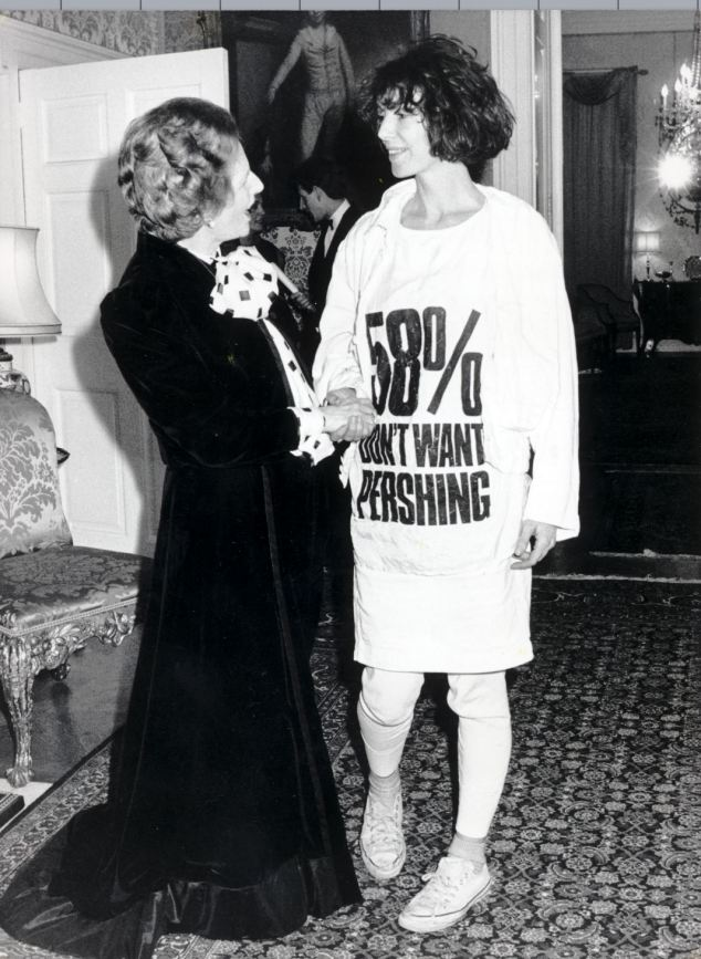 Designer Katharine Hamnett wears a T-shirt broadcasting public opposition to the stationing of nuclear missles in the UK while meeting Margaret Thatcher in 1984.
