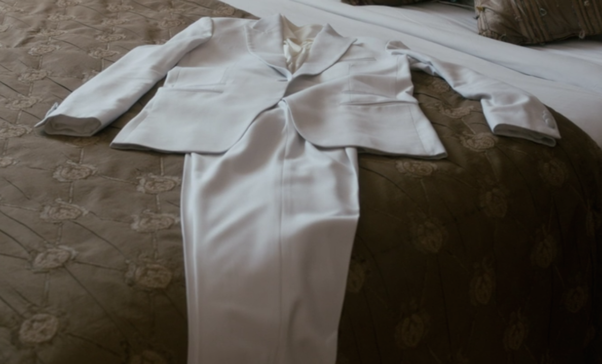Nessa's immaculate white trouser suit for the groundbreaking.