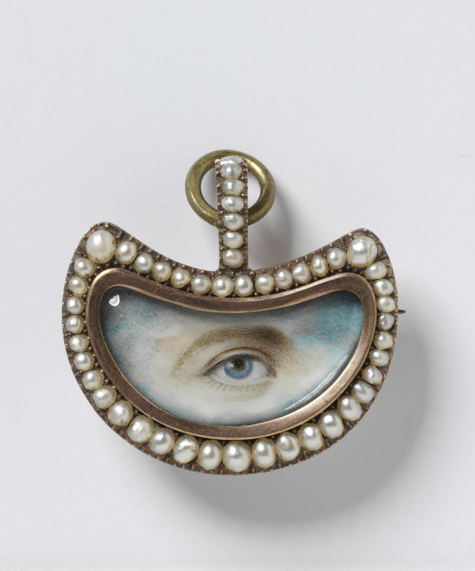 "An early 19th-century miniature eye painting, surrounded by crescent-shaped pearls. Eye miniatures were "" an attempt to capture 'the window of the soul', the supposed reflection of a person's most intimate thoughts and feelings,"" per the Victoria & Albert museum. © Victoria and Albert Museum,"
