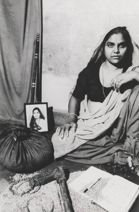 'Shanti,' Sheba Chhachhi, 1991. In her series of staged portraits, 'Seven Lives and a Dream,' Chhachhi, an activist as well as a chronicler of India's feminist movement, captured women surrounded by objects of their own choosing. Dakshinpuri, Delhi, 1991, printed 2014. Courtesy of the Tate Collection.
