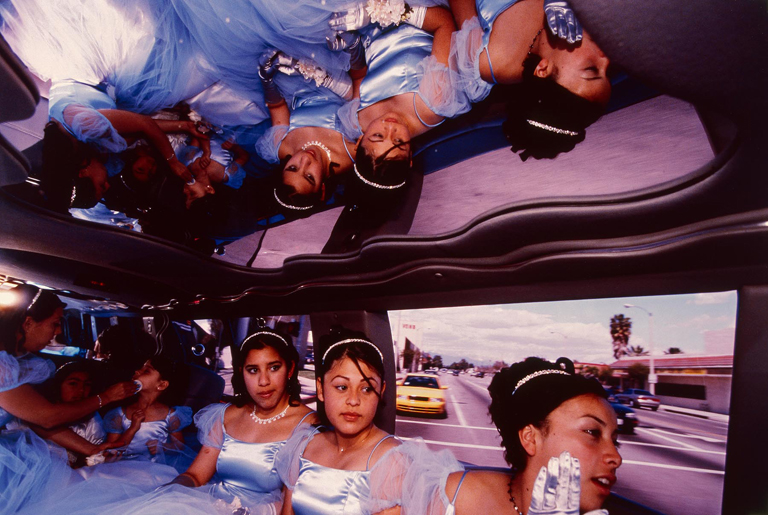 "The ""damas"" (maids of honor) go from the church to the reception in a Ford Explorer limousine at Ruby's ""quinceañera,"" Huntington Park, California, 2001, Lauren Greenfield, Courtesy of Milwaukee Art Museum"
